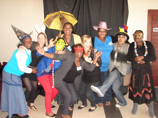 Carers and volunteers at last year's event strike a pose in the fun photo booth