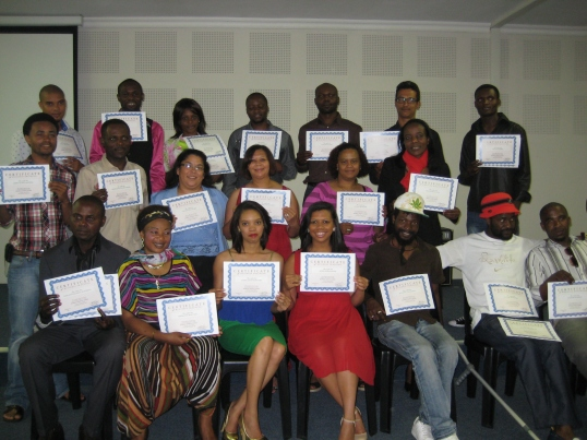 The Paradigm Shift graduates strike a pose with their certificates.