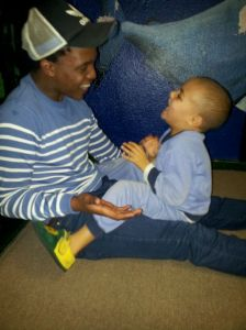 Getting in some play time during the Frequency clothing drop at Christine Revell Children's Home