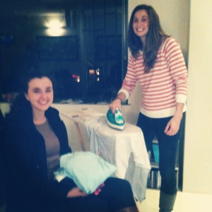 Maegan and Emily ,from the Rondebosch PM congregation. diligently ironing the clothes before delivery