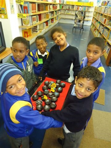 Literacy Programme learners waiting to tuck in to the celebratory cupcakes :)