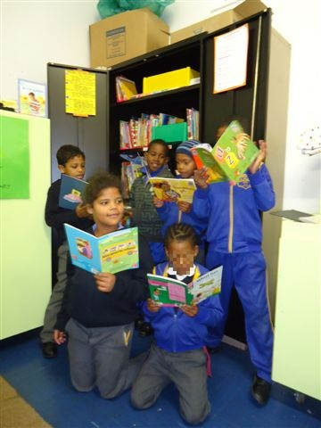 The learners enjoying the new books :)