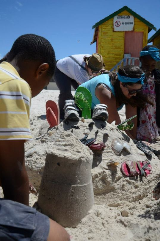 A sand castle building competition under way