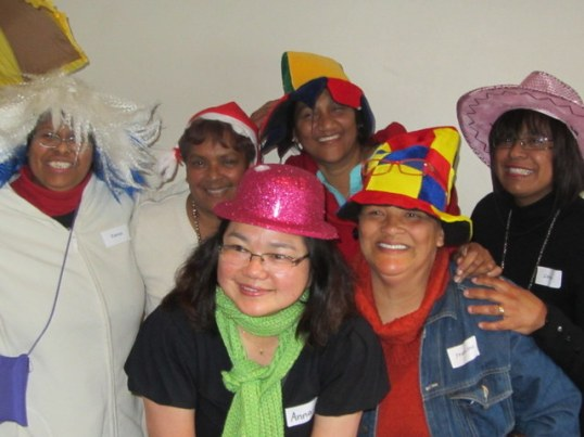 Teachers from Garlandale Primary and volunteers dress up for the photo booth